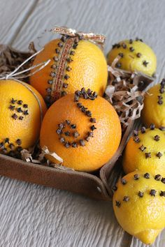 orange and lemon pomanders...just love the aroma of the cloves & mixed spices  mixed with lemon, lime and orange.....great moth and silverfish repellent..