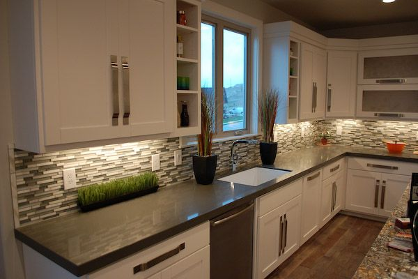 love this kitchen!! white shaker cabinets, white/grey glass tile backsplash, grey (polished concrete) counter, grey wall color.