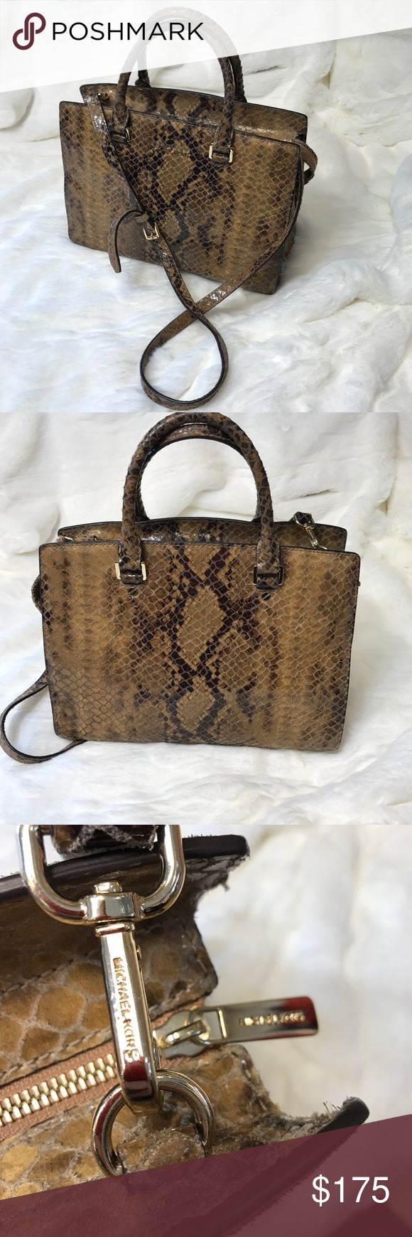 MICHAEL Michael KORS PURSE B122 Slithery snake! Brown and tan shiny and plush snake skin look. This gorgeous handbag has two short handles 14 inches and a 45 inch removable long strap. Soft gold metal detail. Full top zipper. 13x9 inches and about 6 inches wide. In great condition no tears, scuffs, rips. 4 open pockets and one zipper pocket and key tag on the inside. Has pen marks on the inside. Pre-loved. 8226-376 MICHAEL Michael Kors Bags Satchels