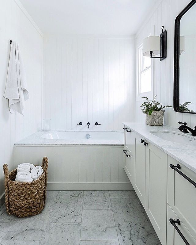 Black white and marble in this modern farmhouse bathroom