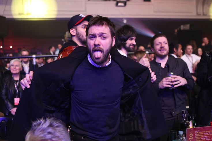 Tom Meighan's clearly been enjoying the complimentary alcohol - or maybe he's just happy with Kasabian's haul of three awards. http://nmem.ag/JiV2I