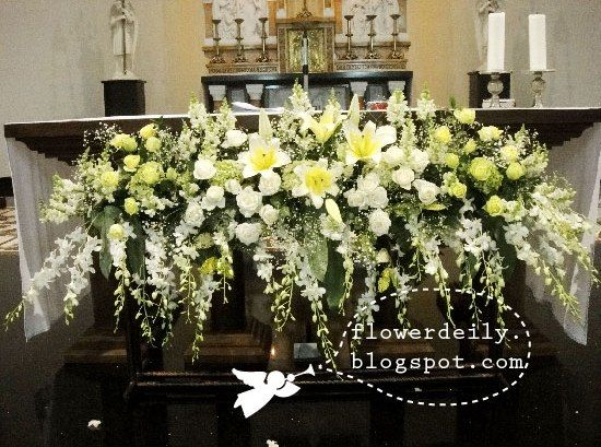 Glorious Flower Arrangements In Front Of The Main Altar Using Popular White Theme