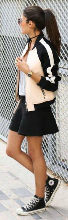Converse + bomber jacket + perfect combination + truly retro fifties style + all-American style varsity bomber + throwback item + cute black mini skirt + classic black + Chuck Taylor + Federica L.   Bomber: Mango, Skirt: Zara, Shoes: Converse.