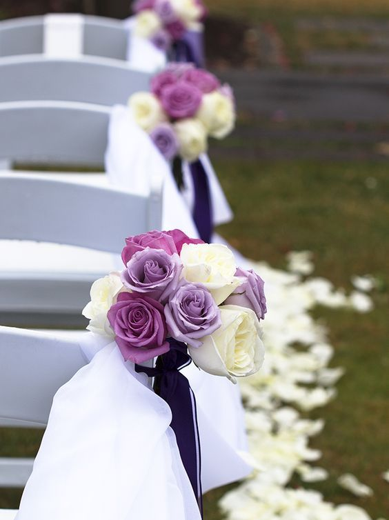 Elegant purple and white rose wedding ceremony chair decor; Featured Photographer: Stationery Bike Designs