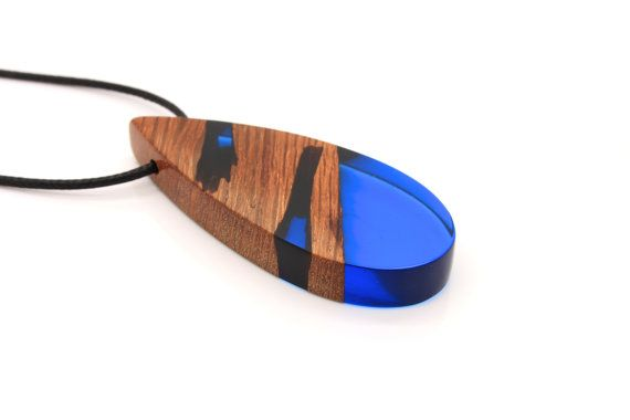 Reclaimed wood and blue resin pendant necklace. Elegant nature. Handmade jewelry by WoodAllGood. #WoodAllGood