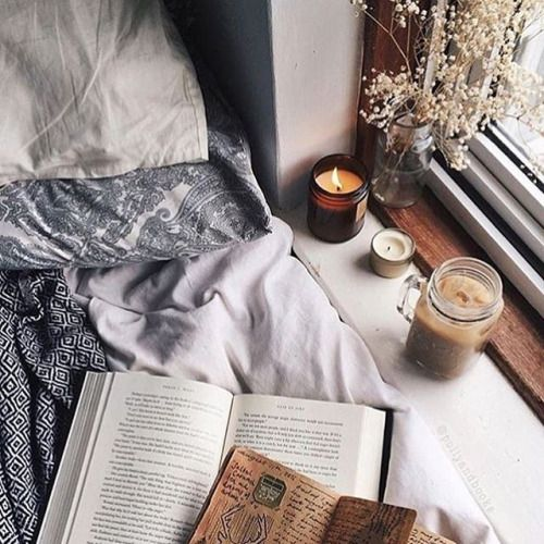 Natural light, a candle and a few books.