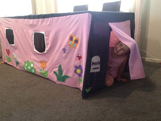 For my daughters 4th birthday my Mum and I (I am not great with a sewing machine) made her this table tent. Simply slips over our dining room table and boom, instant play house. She LOVES it by the way!