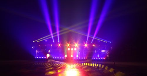 these moving lights are used to help attract people towards them maybe for something like to see a show.  http://www.stagelightingservices.com/_UPLOADED/1391170920_Robe-moving-lights.jpg
