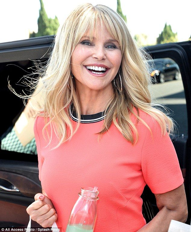 Organic wine: Christie Brinkley promoted her new Bellissima brand of white wine Wednesday ...close-up, orange coral peach dress, smile, long hair. June 2017
