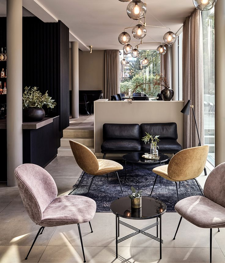 Lounge of the Mauritzhof Hotel in Münster, Germany. Love the muted tones and mix of soft textures.
