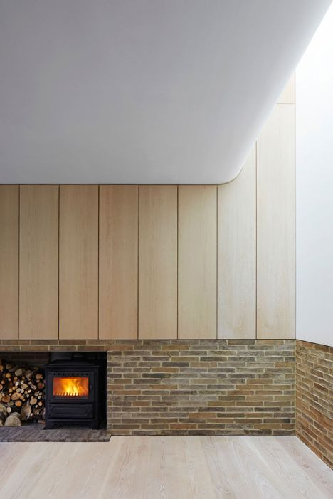 Architecture studio Piercy & Company has slotted a family house behind a nineteenth-century stable facade in south-west London