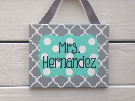 Gray quatrefoil and and Aqua and white polka dot center are a cheerful combination and a great way to introduce yourself to new students or visitors to your school! This teacher name sign makes a great gift for your favorite teacher, a first year teacher, graduating student teacher or a teacher getting married and changing her name! This canvas measures 8x10. This made to order sign can be customized in any colors or patterns you would like. Please include the name you would like on the sign…
