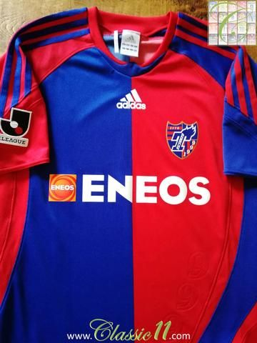 Official Adidas FC Tokyo home football shirt from the 2009/2010 season. Complete with J. League patch on the sleeve.