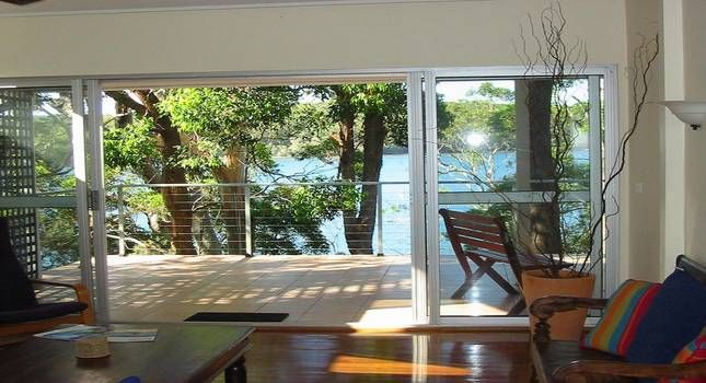 Smiths Lake Accommodation, Amaroo On The Waterfront for your pet friendly holidays on the beach. #beachholidays #beach #petfriendly  www.OzeHols.com.au/1