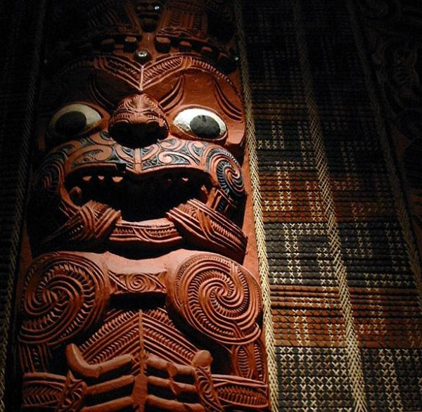 This stunning carving is an example of the decorative carving inside a dwelling, here the Maori meeting house of Hotenui in the 19th century. The panels next to it are tukutuku wall panels and show the beautiful weaving that was done at the time as well.