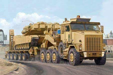 Oshkosh M1070 HET with an M1 Abrams in tow.
