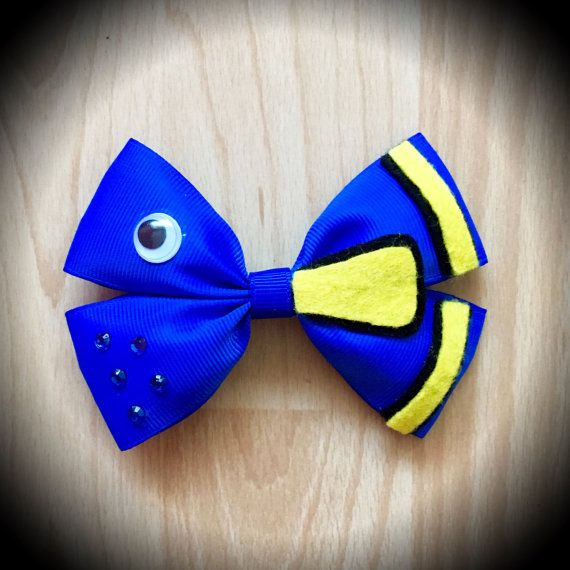Finding Dory Disney Character Inspired Hair Bow.  Blue Grosgrain Ribbon Decorated with Black and Yellow Felt Fish Accents, Eye feature and rhinestones.  Mounted on an alligator clip.  I can do custom bows, just let me know if youd like something specific.  Price is for single bow.