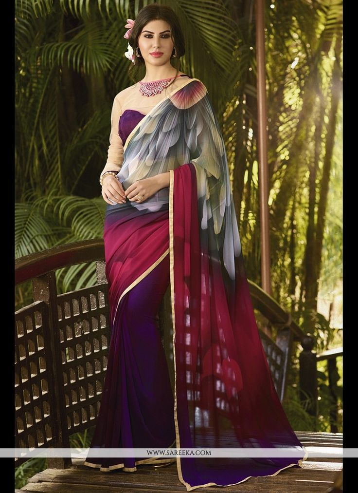 Women splendor is magnified tenfold in this alluring multi colour georgette printed saree. This engaging dress is displaying some brilliant embroidery done with print work. Comes with matching blouse....