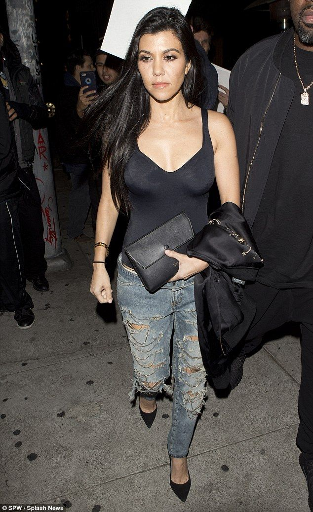 Feeling wistful: Kourtney Kardashian - pictured Thursday at The Nice Guy in West Hollywood - can't be happy to hear that Scott Disick was hanging out with beautiful women in Mexico this week