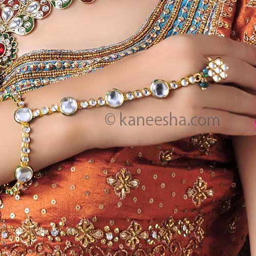 Eyecatching Kundan Ethnic Finger Ring Bracelet  Price: Usa Dollar $22, British UK Pound £13, Euro16, Canada CA$ 24, Indian Rs1188.
