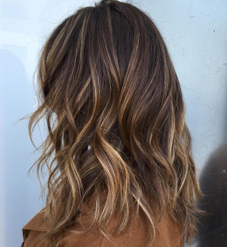 Balayage with thin honey and caramel highlights above mid shaft and thick highlights below.