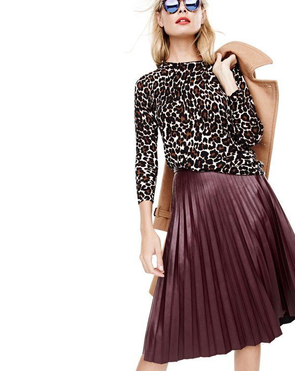 J.Crew women's Tippi leopard sweater, icon trench coat, faux-leather pleated midi skirt and Illesteva™ Leonard mirrored sunglasses in tortoiseshell.