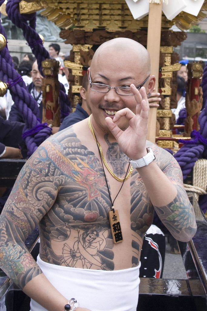 Happy yakuza at Sanja Matsuri, one of the most famous festivals in Japan: article says that 70% of its Mikoshi groups controlled by yakuza