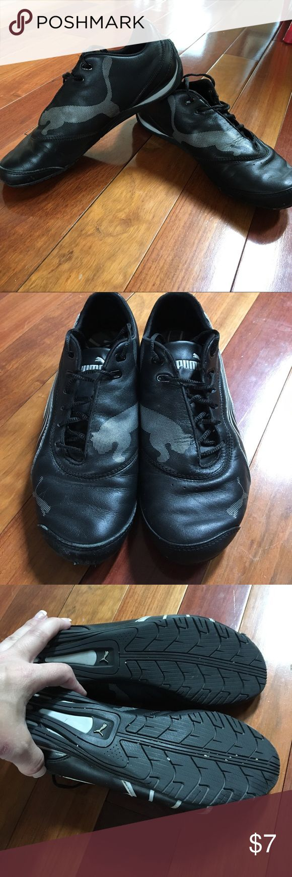 PUMA Black Tennis Shoes! Size 7, PUMA black tennis shoes with signature logo and striping in silver. Good used condition with wear on left front (see picture). Price reflects this. Bundle and save! Offers welcomed 👍 Puma Shoes Athletic Shoes