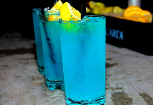 For our Something Blue drink. Blue Hurricane New Orleans Style: 1 oz white rum, 1 oz Jamaican dark rum, 1 oz blue ciraco, 1/2 oz grenadine, 3 oz oj, 3 oz pineapple juice, crushed ice, pineapple chunk  a cherry for decor