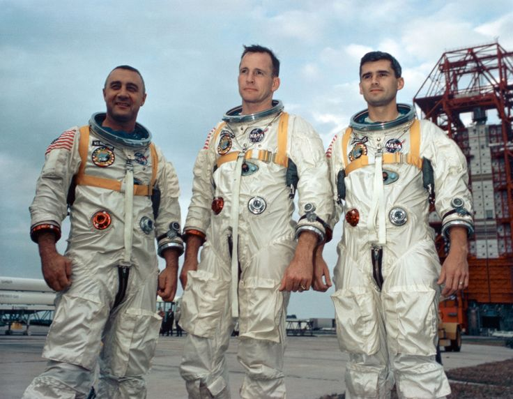 Apollo 1 Crew Honored Astronauts from the left Gus Grissom Ed White II and Roger Chaffee stand near Cape Kennedy's Launch Complex 34 during training for Apollo 1 in January 1967.
