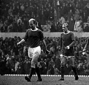 Bobby Charlton and Denis Law trudge off at half time on a rainy day at Old Trafford in 1969.