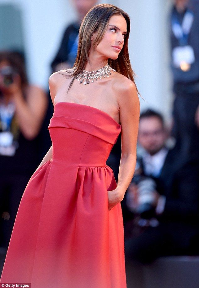 Evening look: The 33-year-old supermodel wore a red Alberta Ferretti gown to the premiere ...
