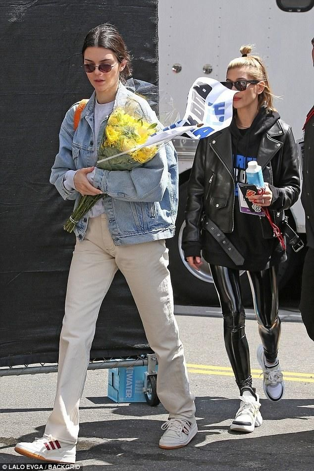 Kendall Jenner wearing R13 God Save Us Trucker Jacket, Heron Preston Silver  Backpack, Adidas Forum Low Sneakers in Chalk and Yeezy Season 5 Crewneck  Sweater fdaf95e064