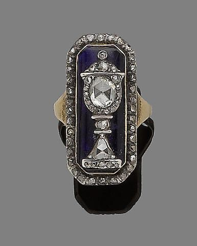 Blue glass and diamond mourning ring, mounted in silver and gold. The urn is a typical element of mourning jewelry of this period. English c1800. Bonhams.