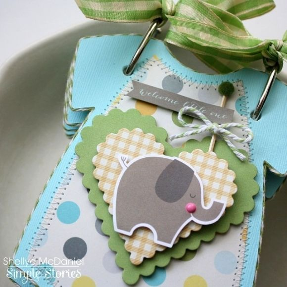 Hi there! Shellye along today with a handsome little mini album made with pieces from the SN@P! Baby Boy Set and a onesie shaped die by Top Dog Dies. I love to make small albums such as this to give as gifts to a new mom or grandma...they're the perfect size for a brag book and display so sweetly on a shelf or cabinet!
