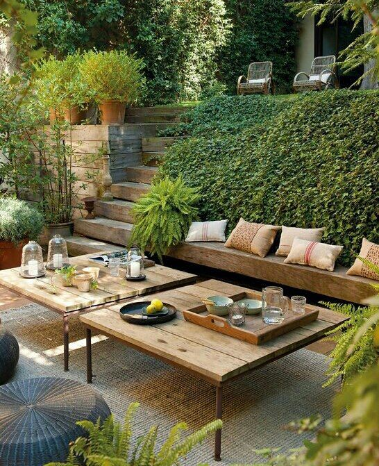 more what i'm thinking-  cascading plants,  seating and table. an area to lounge