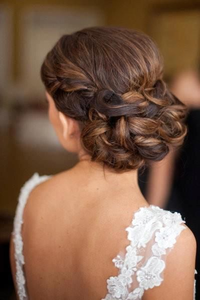 Pretty braided bun, elegant bridal look paired with cathedral veil then replaced with a rhinestone hair comb