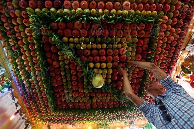 made of fruits inside a Samaritan's house is seen during the #Sukkot Holiday ( Tabernacles Feast) in #Nablus, West Bank, on October 17, 2015. It is a biblical #Jewish #holiday celebrated on the 15th day of the month of Tishrei (varies from late September to late October) marks the exodus of the Hebrew people from Egypt on ancient ages.#issam_rimawi #aa