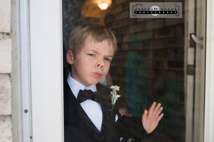 Markham Wedding Photography, ring boy puts knows against glass, waiting to go.