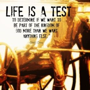 A statue of a Mormon pioneer pulling a handcart. And a quote about life being a test from Sheri Dew.