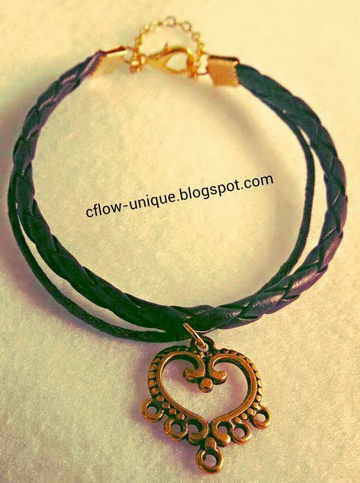 Sweet bracelet is made of imitation leather strap, chain, and charm.