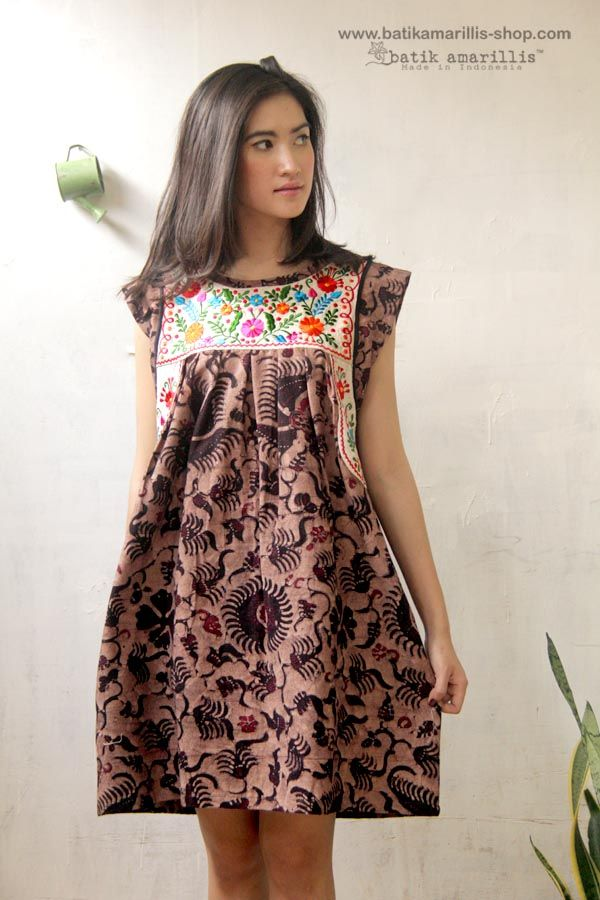 Batik Amarillis Made in Indonesia ...This magnificent  Mexican traditional inspired tunic is super pretty & comfy with its bold & beautiful embroidery,very versatile ,you can wear it with belt or over your skinny pants and jeans! made with  Batik Tuban on Muslin & mexican embroidery