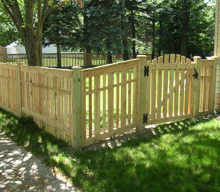 Amazing Spaced Provinicial Wood Fence With Arched Gate By Elyria Fence