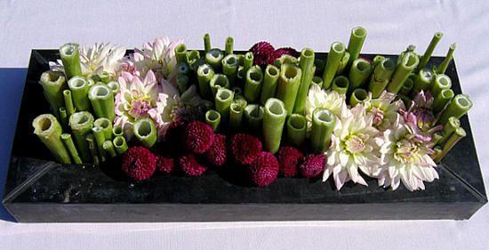 Bloemschikken herfst: bloemstuk maken met dahlia's in polygonumstokken