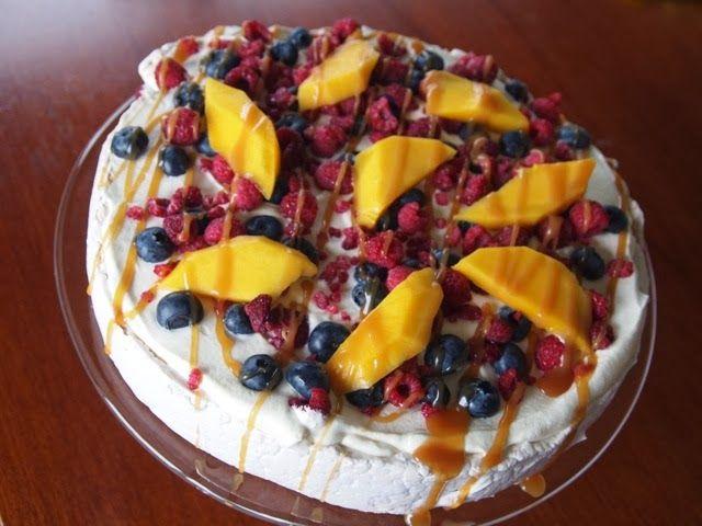 Raspberry pavlova with fresh fruits and salted caramel sauce
