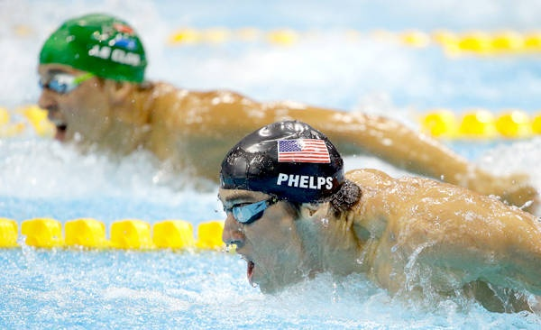 Can't win 'em all - Michael Phelps fails to beat South Africa's Chad le Clos (green cap) in the men's 200-meter butterfly final on Tuesday. The silver medal was Phelps' 18th career Olympic medal — he would win his record-breaking 19th later in the day when the US 4x200 relay team took the gold.