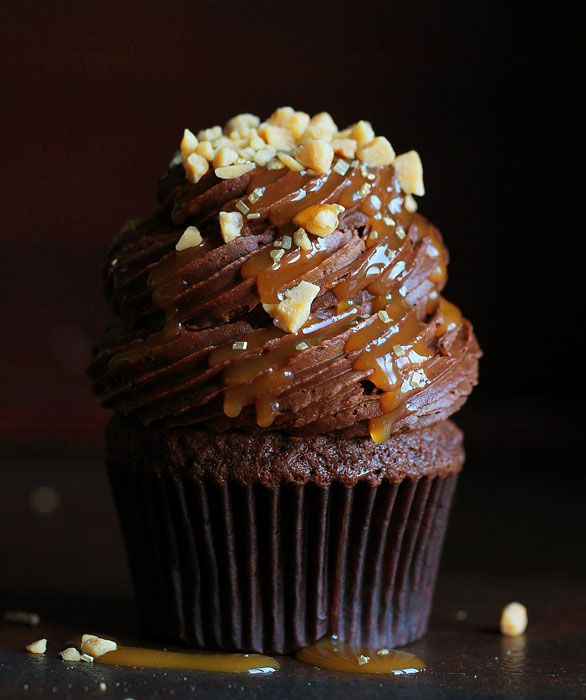 Double Chocolate Caramel Heath Cupcakes are an indulgent way to treat yourself! It started off as a craving and ended up so darn pretty that I didn't want to eat it! To make these cupcakes you will need: Chocolate cupcake recipe (below) Chocolate frosting recipe (below) Caramel sauce Heath chips Muffin pan and cupcake liners...