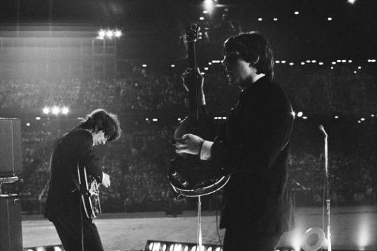 """The Beatles onstage at the Metropolitan Stadium, Bloomington, MN, 21 August 1965    Photos: Bob Bonis    """"These guys are amazing. They are electric. I mean look at those girls. I think the girls want them if you know what I mean, but what makes it so unstoppable… is the music. Ya mix the music with the men, and what have you got? Hysteria."""" - Bob Bonis to Larry Kane"""