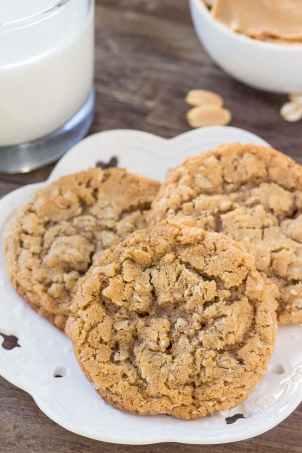 A plate of chewy oatmeal peanut butter cookies and a glass of milk.