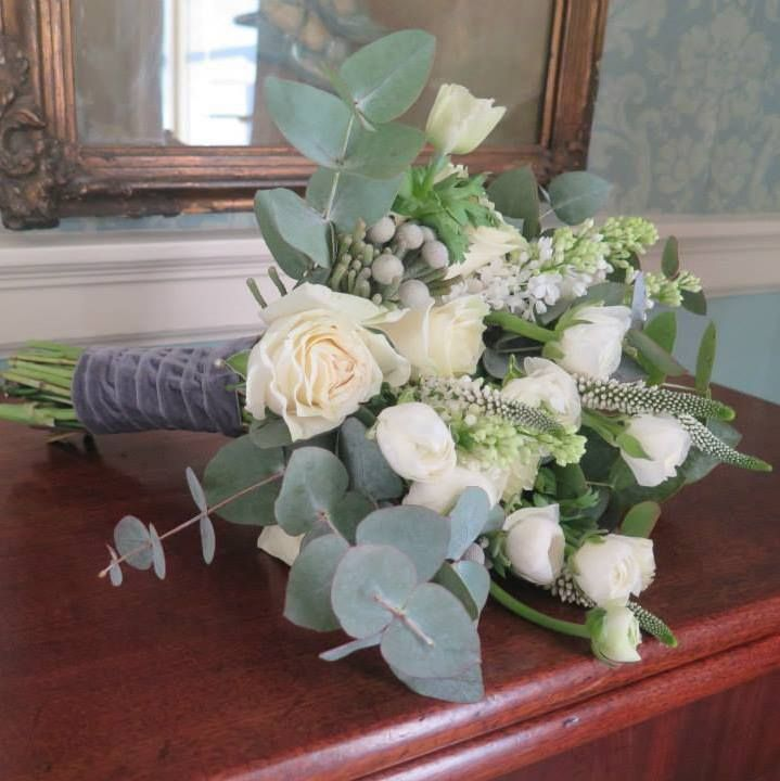 Winter whites bridesmaids bouquet with Roses, veronica, brunia, ranunculus, anemone and syringa